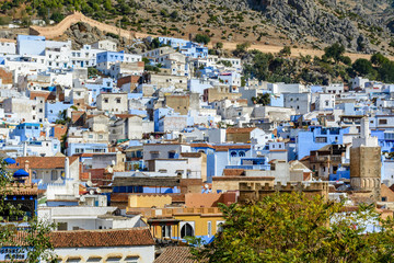 An overlook of Chefchaouen, Morocco with the fortress walls
