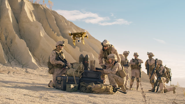 Soldiers are Using Drone And Laptop Computer for Scouting During Military Operation in the Desert.