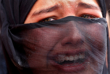 Girl mourns during the funeral of Aaquib Gul in Srinagar