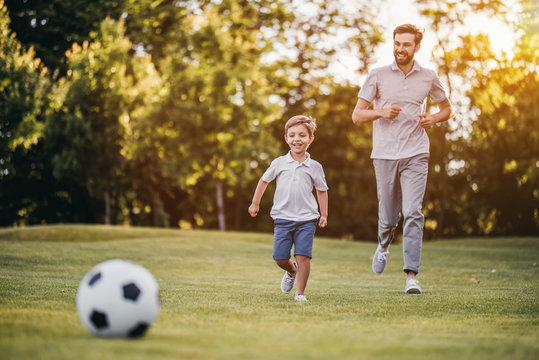 Dad with son playing football