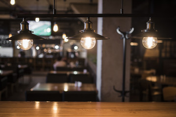 Vintage lamps over a wooden table in a bar 2