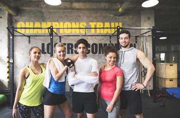 Portrait of confident young people in gym