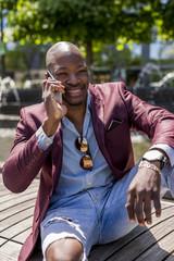 Stylish businessman using mobile phone. Manhattan. New York City.