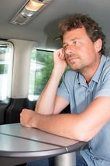 portrait of handsome man in luxury van or camper