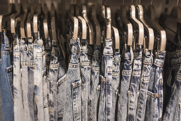 Jeans on hangers close-up