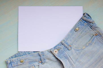 Background with jeans and a white sheet of paper