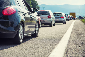 Traffic jam on the highway in the summer holiday period or in a traffic accident. Slow or bad traffic