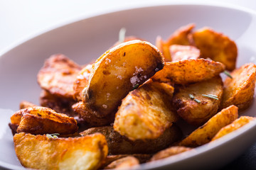 Potato. Roasted potatoes. American potatoes with salt rosemary and cumin. Roasted potato wedges delicious crispy