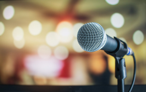 Microphone for speaker on abstract blurred of speech in seminar room or speaking conference for audience at university