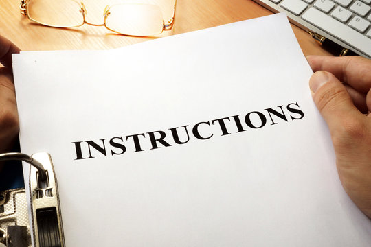 Instructions in a blue folder. Guidebook concept.