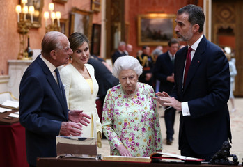 Britain's Queen Elizabeth II, Prince Philip, Duke of Edinburgh and Spain's King Felipe and Queen Letizia look at a display of Spanish items from the Royal Collection at Buckingham Palace