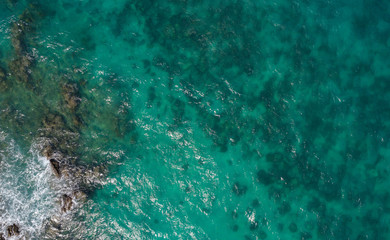 At Sea Island.Aerial view. Top view.amazing nature background.The color of the water and beautifully bright.Azure beach with rocky mountains and clear water of Thailand ocean at sunny day.