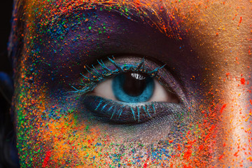 Eye of model with colorful art make-up, close-up Wall mural