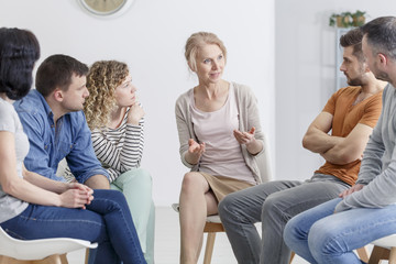 Psychologist encouraging her group