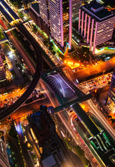 Lights of cars on the road. And views of city lights at night in Bangkok,Thailand.Aerial view.