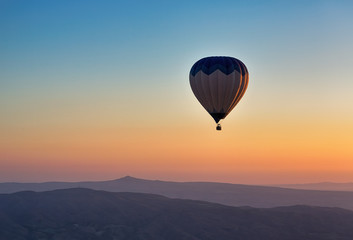 Hot air balloon flight at sunrise.