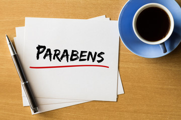 Parabens (Happy Birthday in Portuguese) - handwriting on papers with cup of coffee and pen, concept