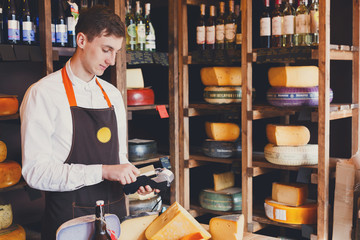 Cheese shop assistant swipe credit card