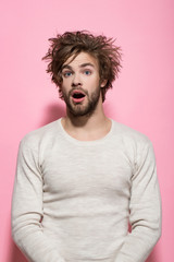 surprised man with long uncombed hair wake up in morning