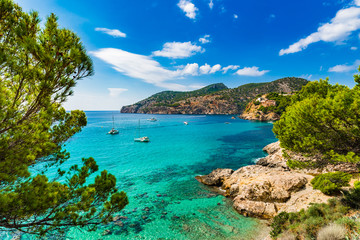 Idyllic sea view scenery of bay with boats on Majorca Island