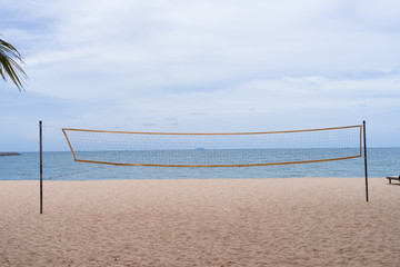 volleyball net on the beach with blue sky