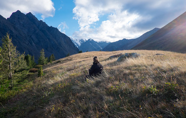 The girl admires the mountain scenery in the Altai Republic