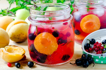 Sangria from apricots, apples and berries
