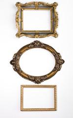 Three elegant, ancient, vintage, museum, gold frames, baroque, on white background