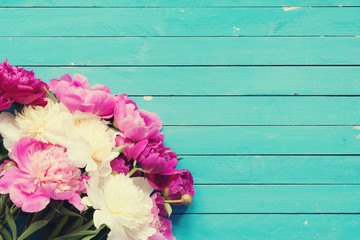 Floral frame / background with beautiful pink, purple and white peonies on old turquoise wooden planks. Shabby chic, vintage flowers for wedding, Happy Mother's day or Women's day