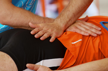 Sports massage therapists work.