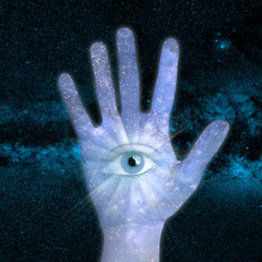 conceptual image of close up hand and universe