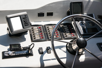 The cabin is a yacht with a steering wheel and other controls.
