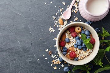 Healthy cereal breakfast with summer berries and farm milk, top view