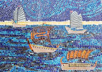 Stone mosaic of sailboats