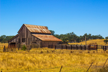 Vintage Wooden Barn With Rusted Tin Roof