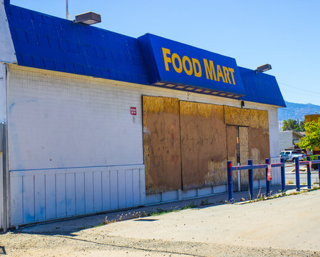 Failed Store With Boarded Up Windows