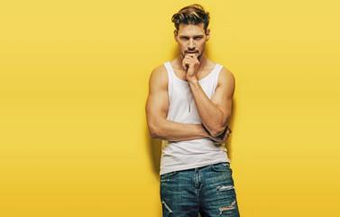 Printed kitchen splashbacks Artist KB Handsome, muscular man posing on a yellow background