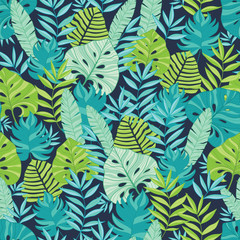 Vector green and navy blue scattered tropical summer hawaiian seamless pattern with tropical green plants and leaves on dark background. Great for vacation themed fabric, wallpaper, packaging.