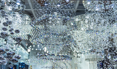 lighting balls on the chandelier in the lamplight, light bulbs hanging from the ceiling,q