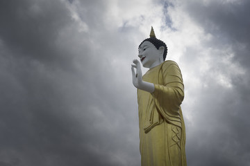Buddha statue standing with dramatic cloud