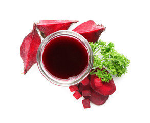Glass of fresh beet juice on white background