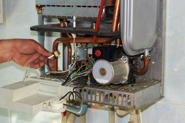 Repair of a gas boiler, setting up and servicing by a service department