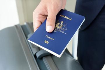 Hands giving passport