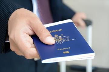 Businessman showing passport
