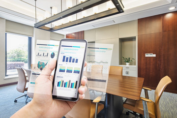 smart phone with business report in modern office