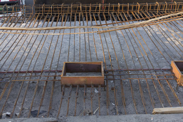 Reinforcement of concrete work. Using steel wire for securing steel bars with wire rod for reinforcement of concrete or cement.