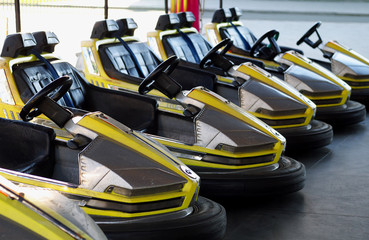 Foto op Canvas Snelle auto s eelctric bumper cars in a row in amusement park