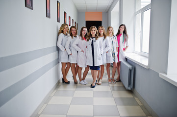 Group of gorgeous young female doctors posing in the hospital or clinique.