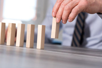 Concept of business progress with wood blocks