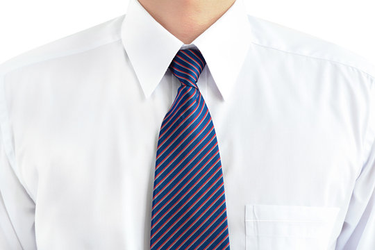 A man wearing white shirt and tie